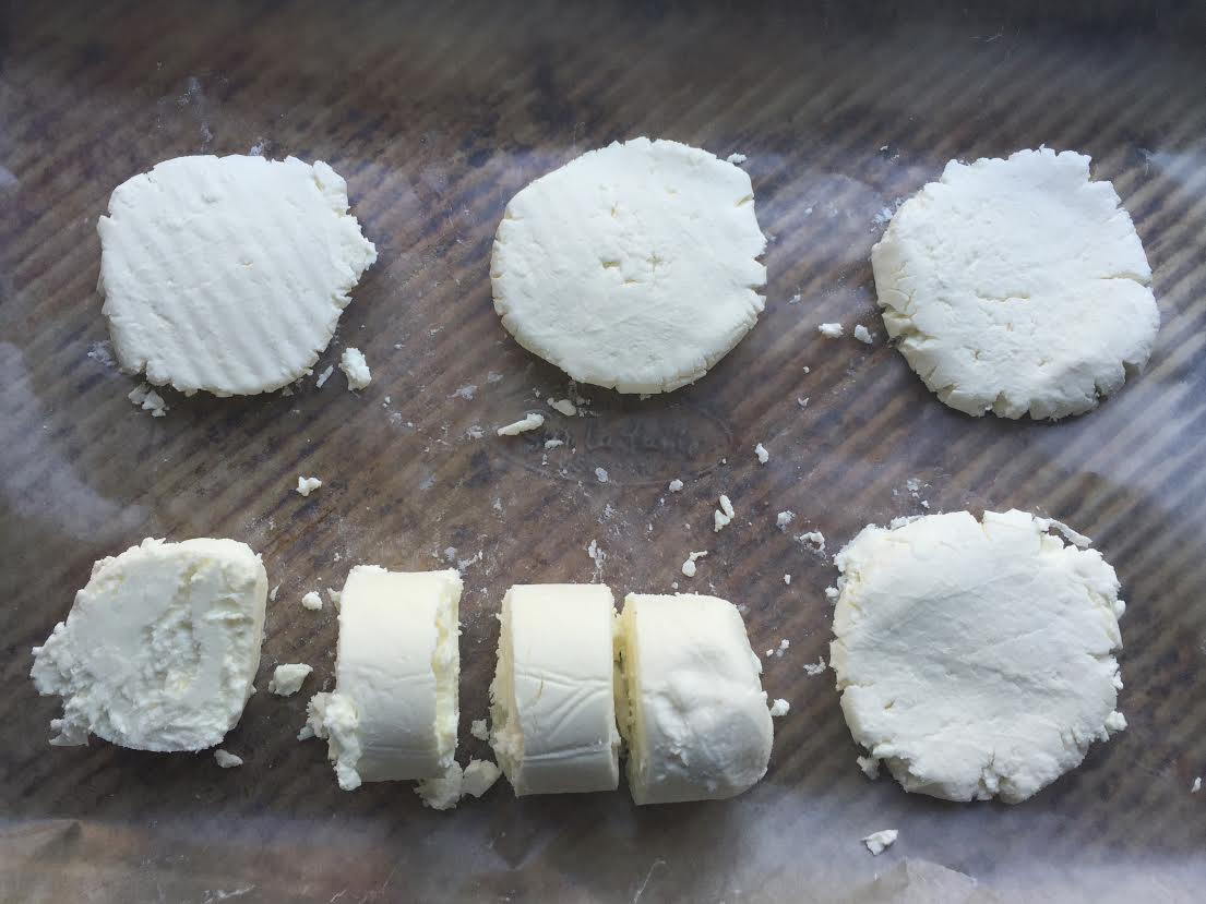 Cut the goat cheese into rounds and flatten them. Freeze them for 20 minutes before dredging. Freeze again before pan frying.