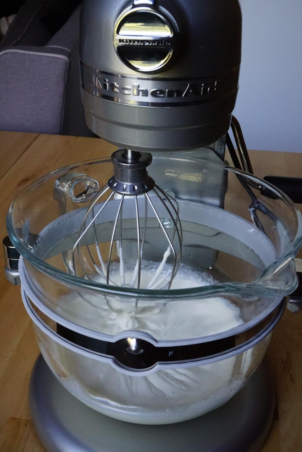 Combine the mascarpone cheese, heavy cream, honey and vanilla extract using the whisk attachment.