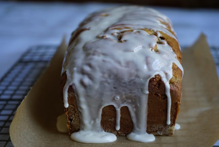Pour the creamy vanilla glaze on the loaf.