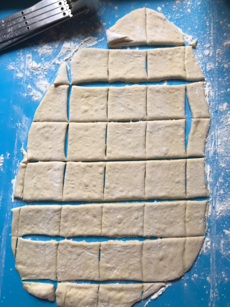 Once the squares are cut, seperate them and place in a heavily=floured spot.