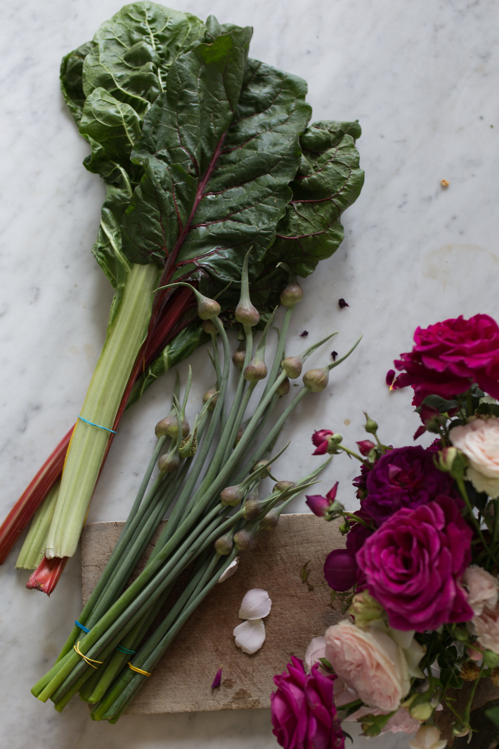 Garlic scapes and garden roses