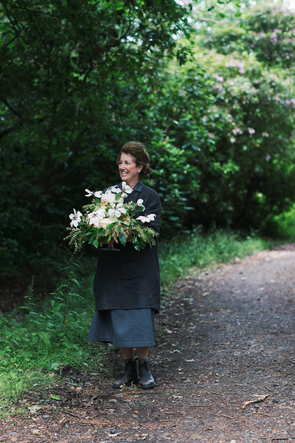 And the cake maker, carrying the cake to the wedding marquee
