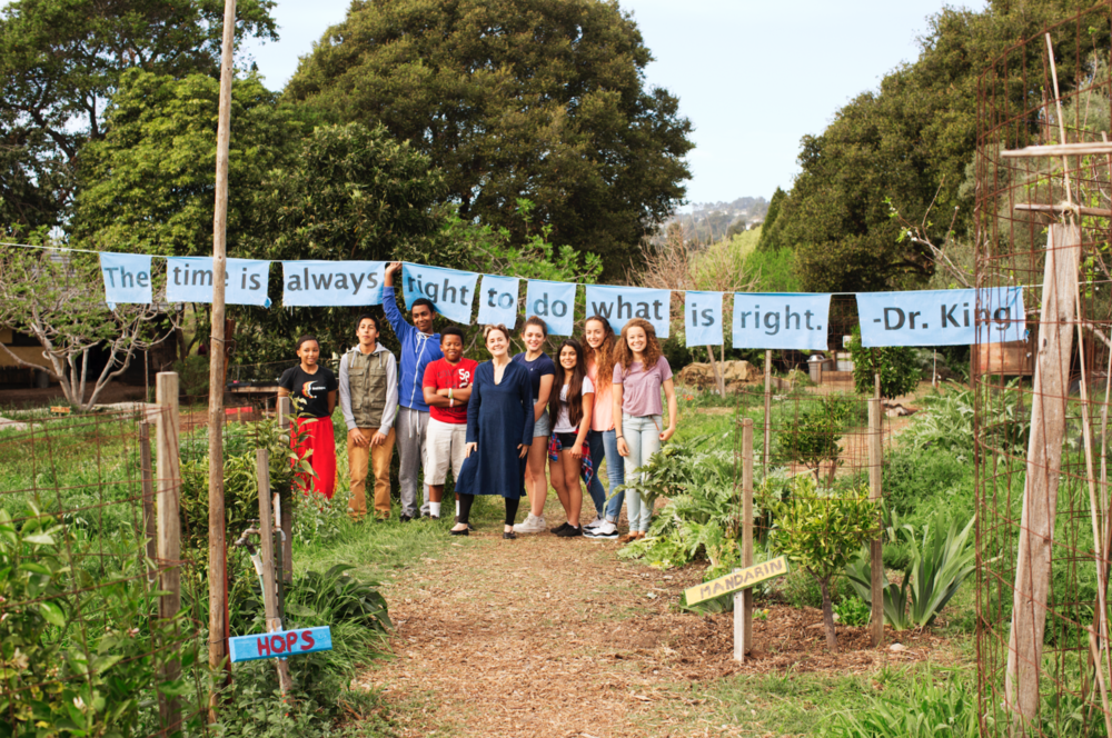 Pictured above: Alice Waters and children in school garden built by the Edible Schoolyard Project.
