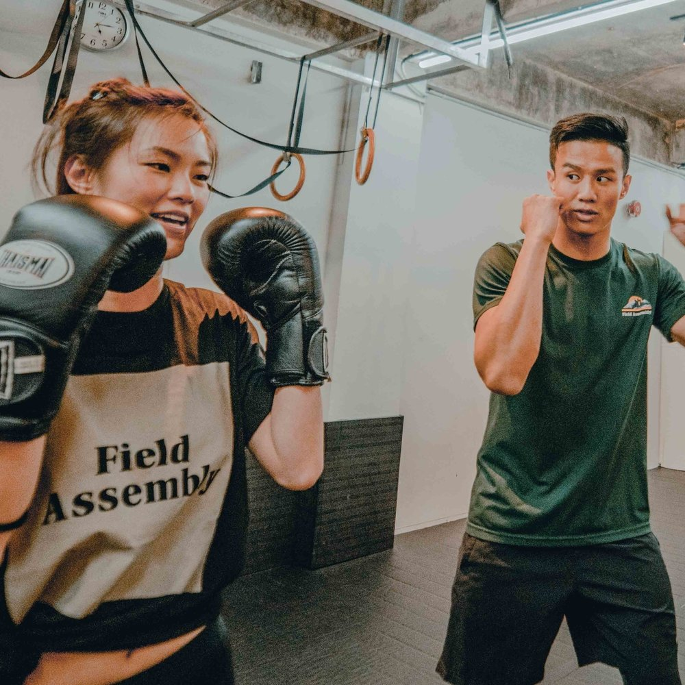 MUAY THAI - HERE'S YOUR NEXT UPGRADE. GLOVE UP AND FEEL YOURSELF GET QUICKER, SMARTER, AND FITTER WITH EVERY CHAMPIONSHIP CLASS. TAUGHT BY REAL FIGHTERS WHO HAVE TRAINED WITH THE WORLD'S BEST. THIS IS MUAY THAI, THE FIELD ASSEMBLY WAY.