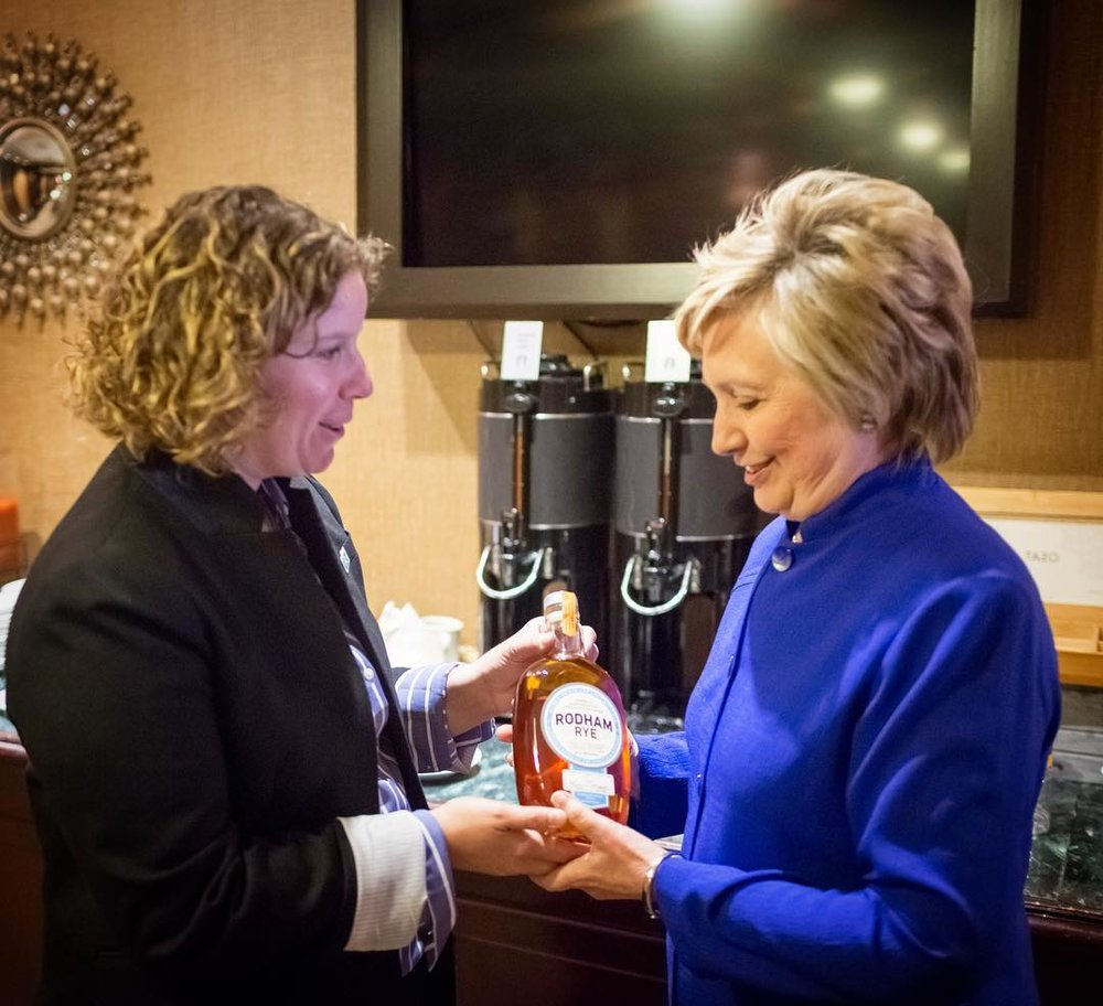 Pia Carusone and Hillary Clinton with Rodham Rye