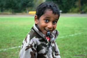coaching football, boy with surprised look, international adoption