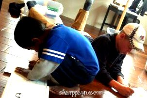 creative boys, working together, homeschool room