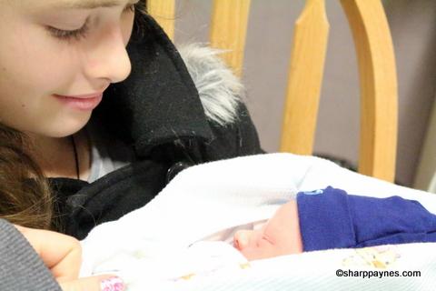 Shelby holding Luke