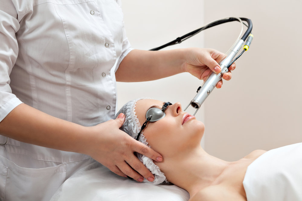 Patient receiving laser treatment for the treatment of aging and sun damaged skin.
