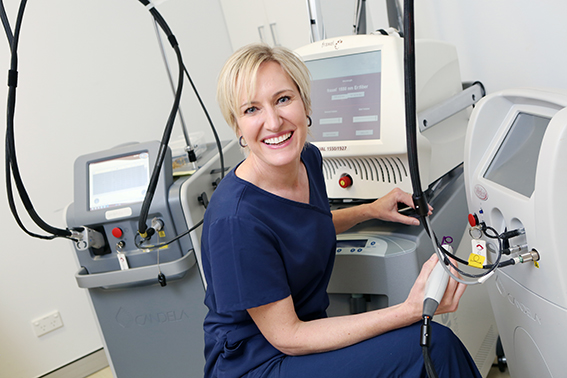 Dr Liz Dawes-Higgs using laser rejuvenation techniques.