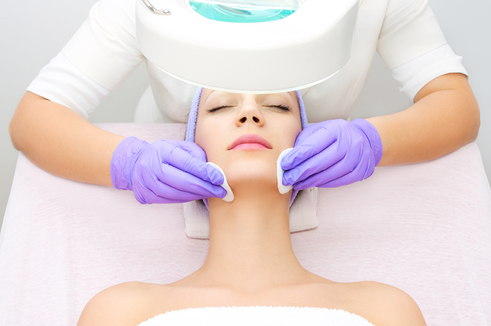 "Patient receiving a s superficial chemical peel, also known as a ""lunch-time peel"" to remove the top layer of dead skin cells."