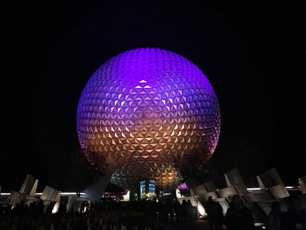 The signature Spaceship Earth attraction  at EPCOT is currently illuminated with Ultraviolet lighting!