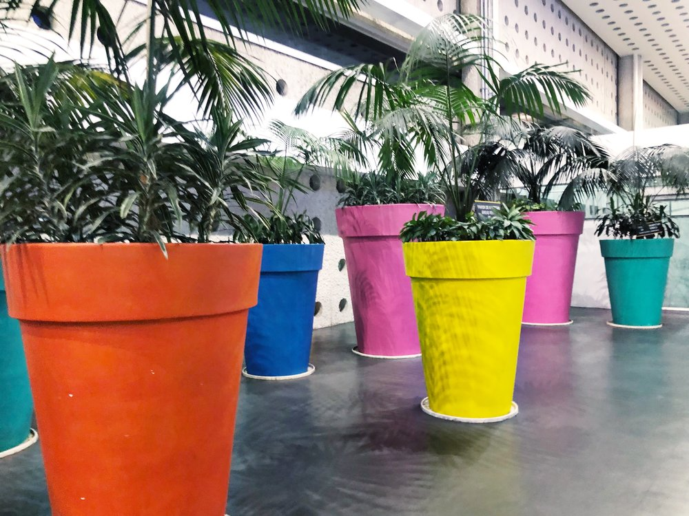 The Mexico City Airport has these huge colorful pots decorating many of the general areas!