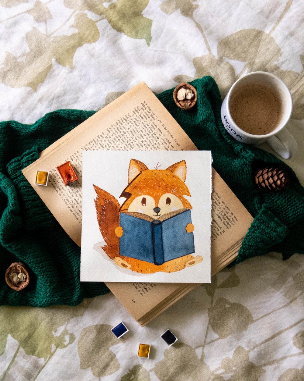 cute fox reading a book