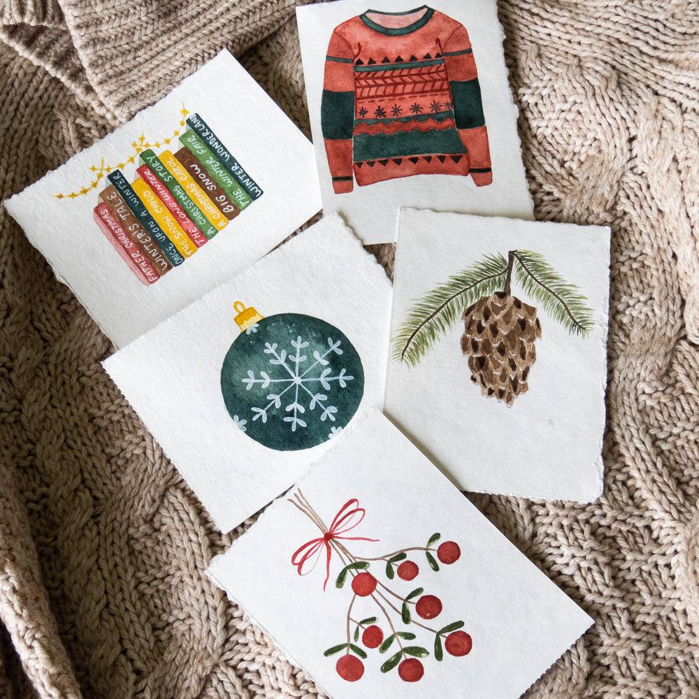 watercolor winter illustrations  pine cone ornament mistletoe books ugly sweater