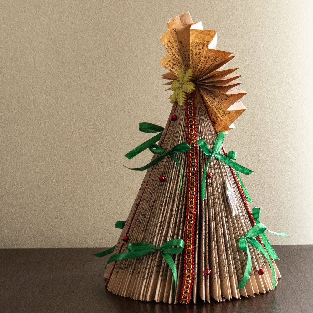 diy mini christmas tree from book pages