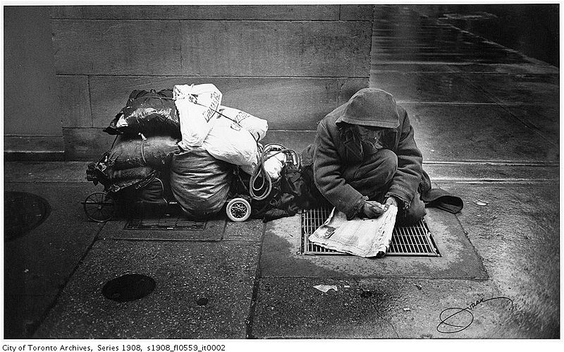 Apparently_homeless_man_doing_crossword.jpg