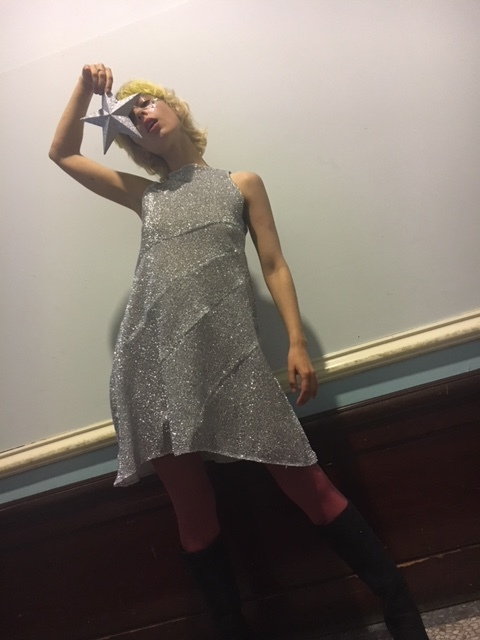Tina wears our Glitter Metallic Mini Dress