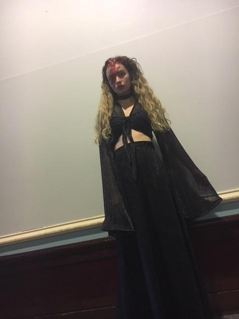 Becca wears our glitter wrap top and velvet maxi skirt
