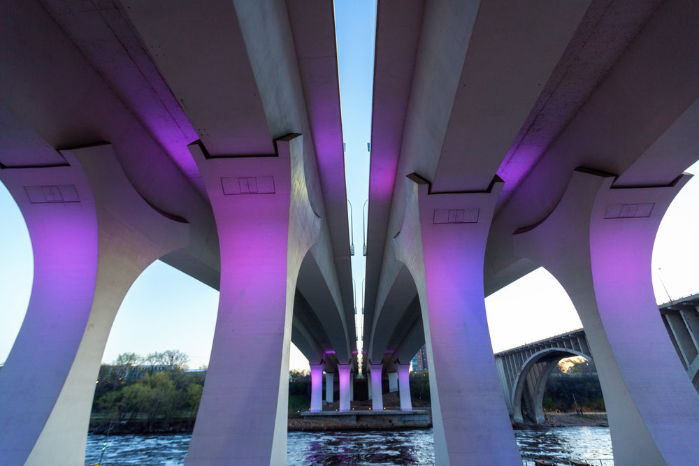 I-35W Bridge glowing purple in tribute to Prince, Minneapolis MN