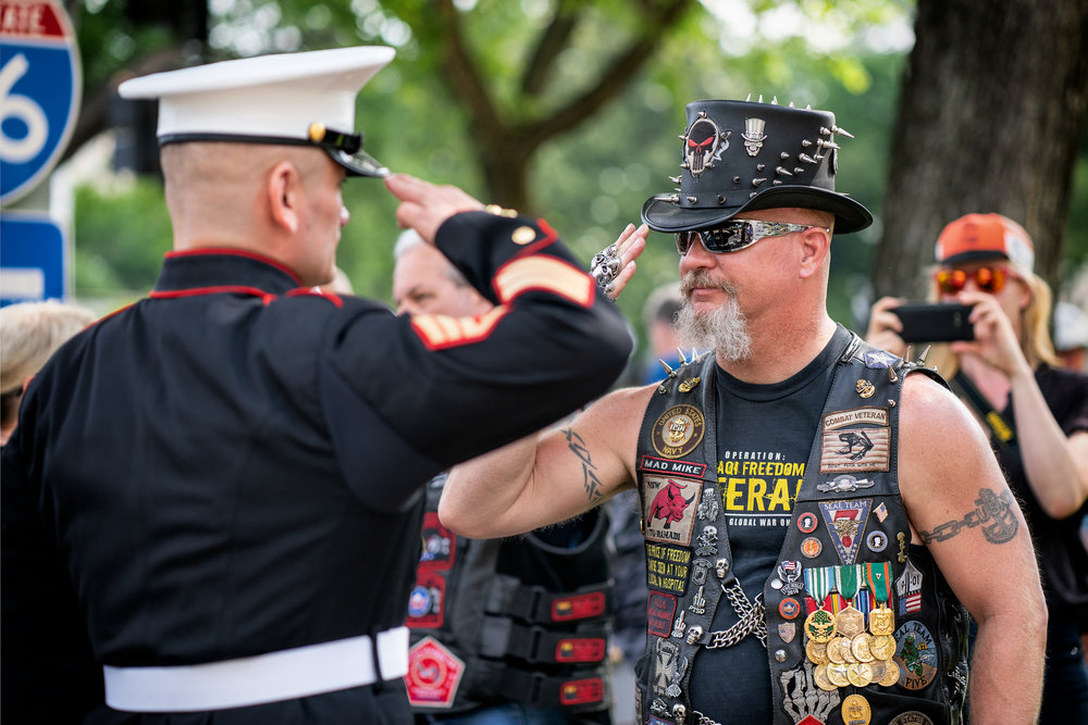 A veteran salutes Tim Chambers, also known as The Saluting Marine on Memorial Day weekend, Washington DC