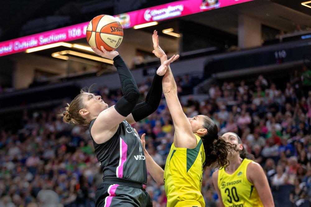 Lindsay Whalen shoots & defends against Seattle Storm's Sue Bird