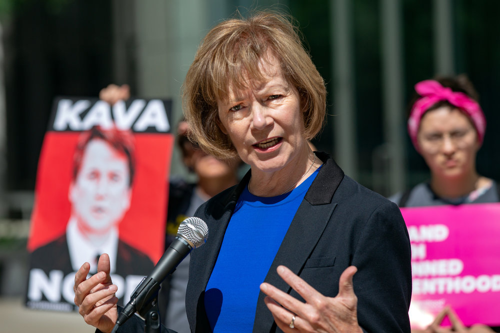 U.S. Senator Tina Smith speaking against the confirmation of U.S. Supreme Court nominee Brett Kavanaugh in front of the Warren E. Burger Federal Building in St. Paul, Minnesota