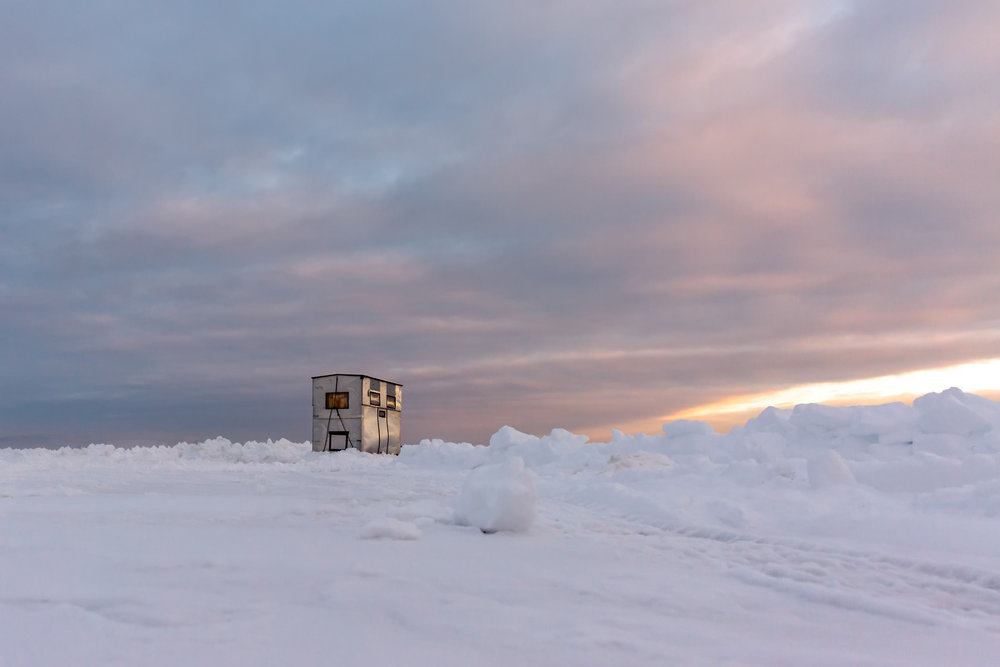 Ice fishing house at sunrise on Fishhook Lake in Park Rapids, Minnesota