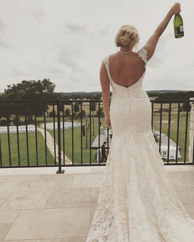 One of our beautiful brides celebrating before the wedding🙌🏼🍾 . . . . . . . #wedding #crickethillranch #weddingfun #weddingseason #bride #drippingspringswedding #hillcountryweddings #texas #tuesday #cheers #champagne