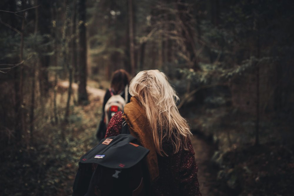 negative-space-blonde-woman-hike-forest-tobi.jpg