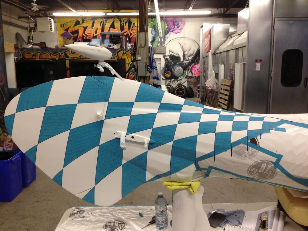 The plane is now ready to spray the first coat. multiple layers of paint must be used, and remasked every time.