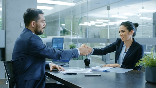 Lender and business owner shaking hands
