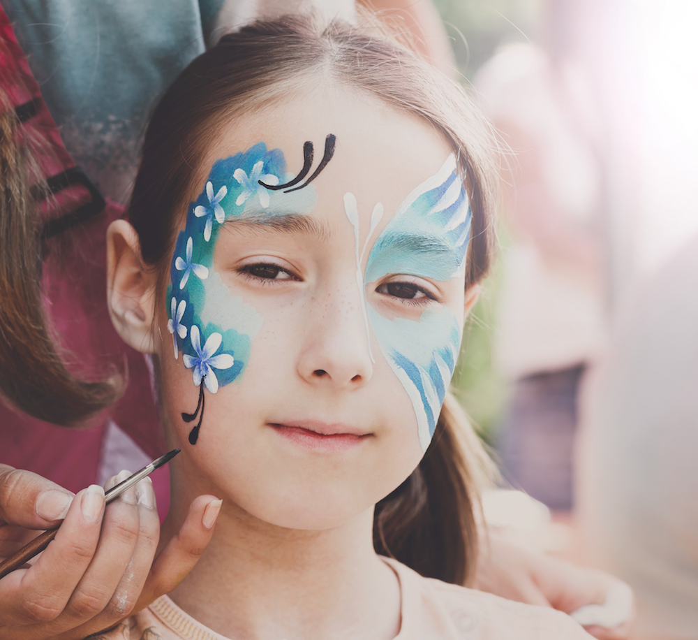 female-child-face-painting-making-butterfly-PN53CFC.jpg