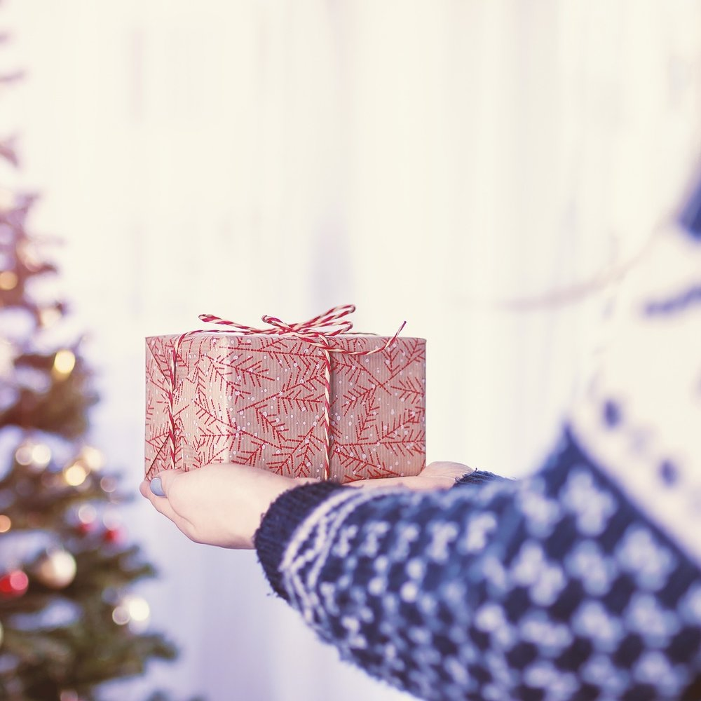 holiday-christmas-hands-gifts.jpg