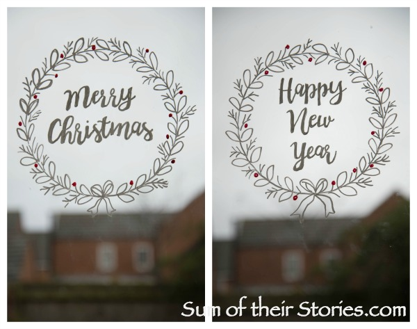 christmas greeting window wreaths.jpg