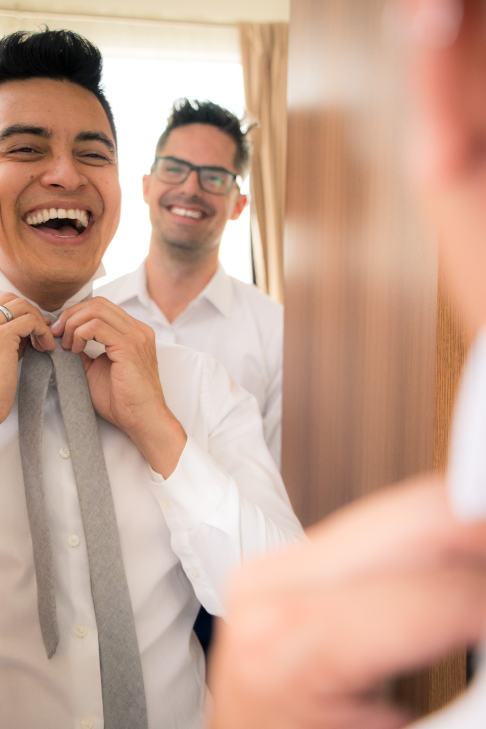 gay couple getting ready and laughing