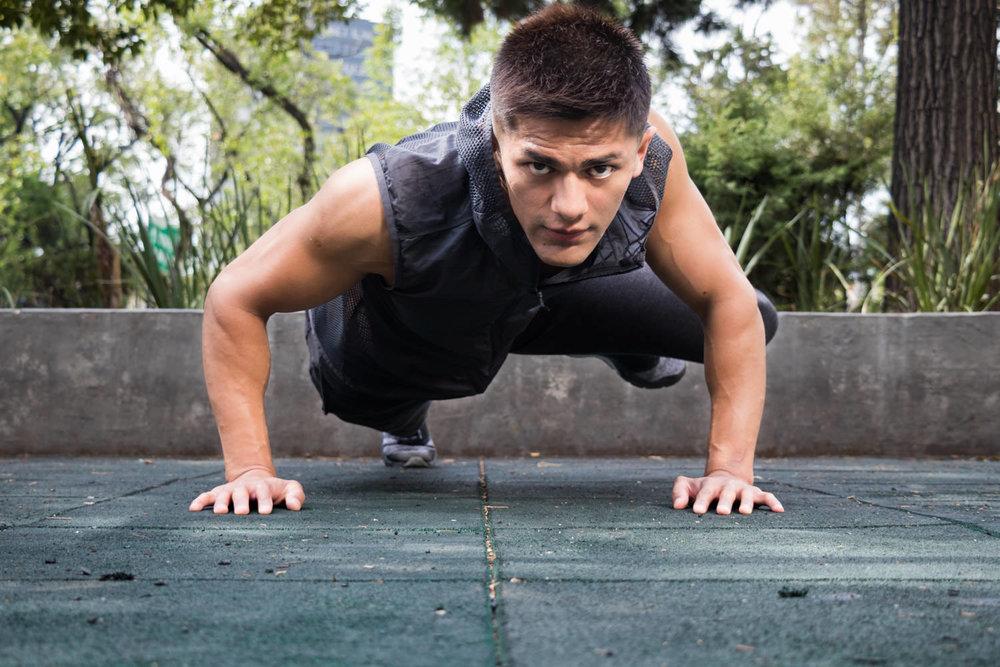 fitness latin guy doing planks