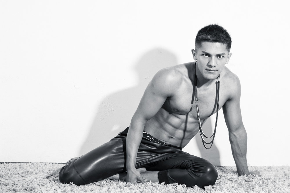 fit guy with top off on the floor