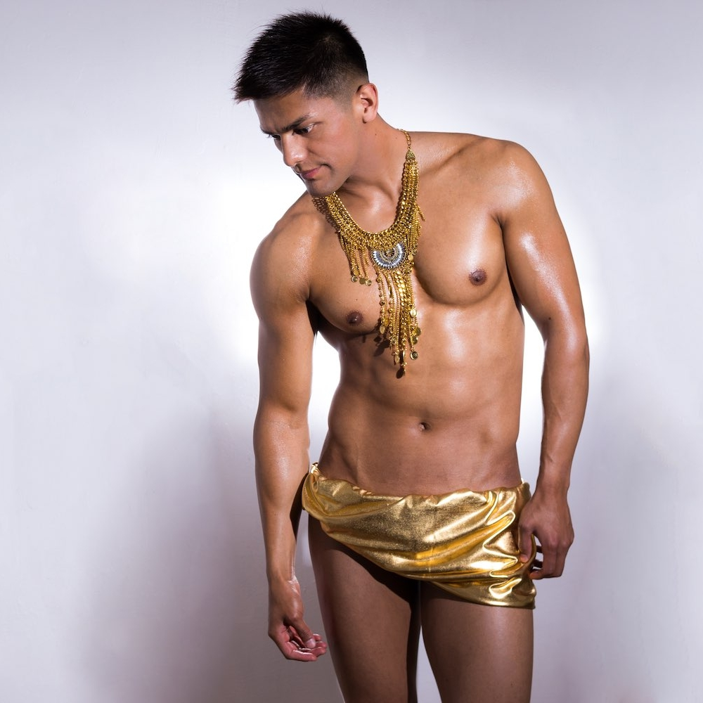 sexy guy half naked with golden outfit