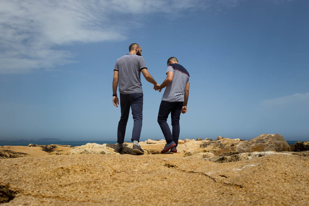 gay couple in the shore holding hands