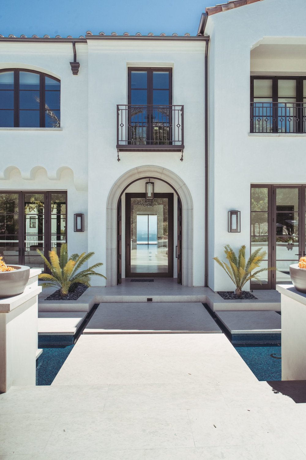 Crystal Cove Contemporary Spanish Revival Entryway by Oatman Architects