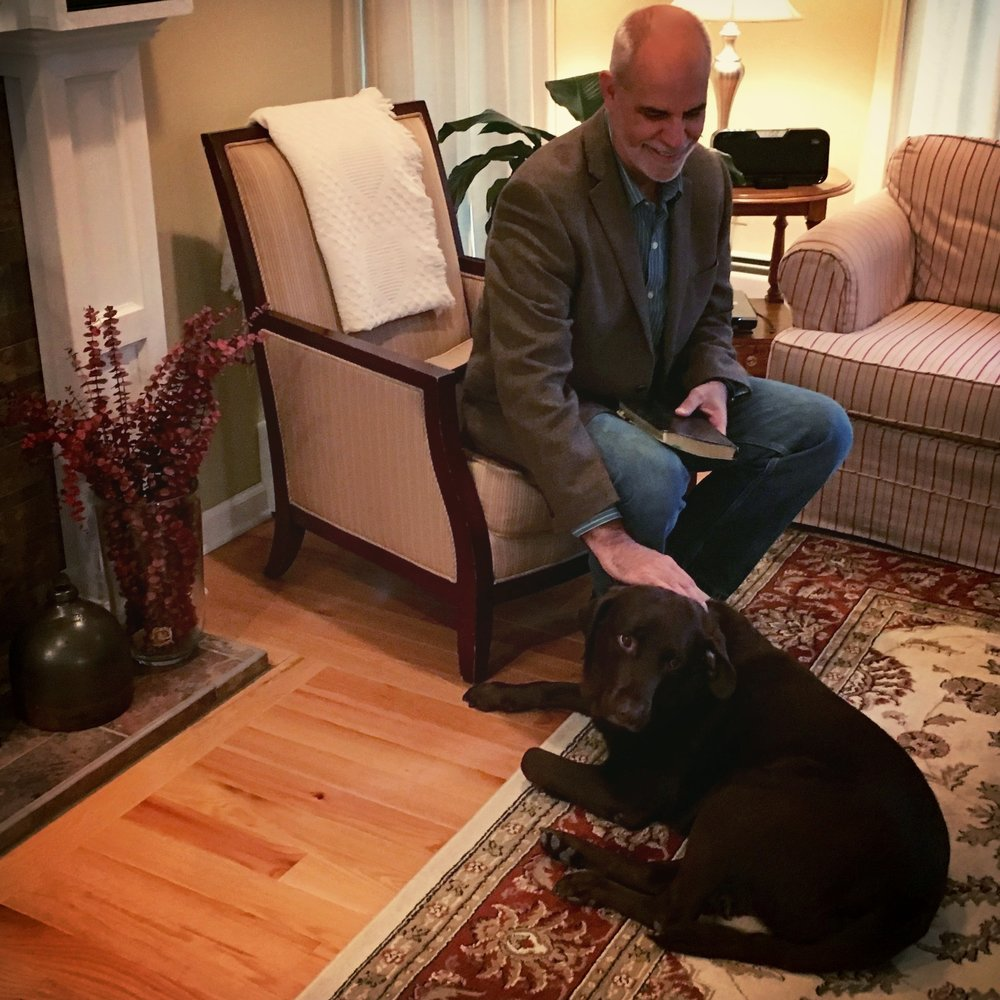 This is Bailey, our rescued chocolate lab. Don't be fooled... he loves mom more than me. He's actually gazing at her off to the right in this very photo.