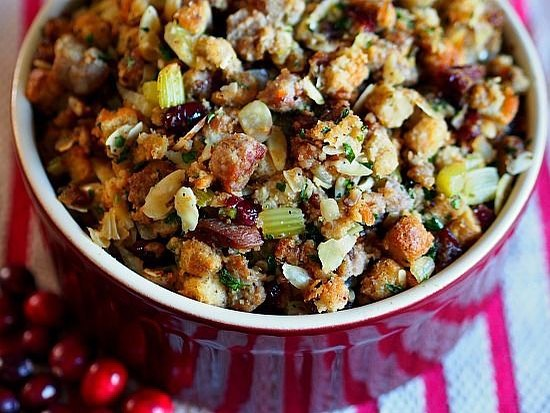 When I think Thanksgiving I think this stuffing. It's been a staple for years thanks to my aunt and I bring it to every Thanksgiving, Friendsgiving, any-giving I can. Even if there is another stuffing I bring this. Try it this year and you'll make it every year.⠀ .⠀ INGREDIENTS:⠀ 2 cups diced dried apricot⠀ 2 cups Grand Mariner (more if you'd like)⠀ 2 cup unsalted butter⠀ 4 cups coarsely chopped celery⠀ 1 jar YUMYIN⠀ 1.25 lb pork sausage⠀ 2 lb herb stuffing mix⠀ 1/2 cup slivered almonds (optional)⠀ 4 cups rich chicken broth⠀ 1 teaspoon dried thyme⠀ salt & freshly ground black pepper⠀ .⠀ DIRECTIONS:⠀ -Preheat oven to 325 F⠀ -Place the apricots and Grand Marnier in a small saucepan. Heat to boiling. Remove from heat and set aside. ⠀ -Melt 1 cup of butter in a large skillet over medium heat. Add the celery and YUMYIN and saute for 10 minutes. Transfer to a large bowl.⠀ -In the same skillet, cook the sausage, crumbling it with a fork, until it's no longer pink. Remove from heat and add to the celery & YUMYIN mixture.⠀ -Add the stuffing mix, apricots with the liquid, the optional almonds.⠀ -Heat the remaining 1 cup butter and chicken stock just until the butter melts. Pour over the stuffing mixture. ⠀ -Stir well to moisten the stuffing, adding the thyme, salt and pepper to taste.⠀ -Bake stuffing in a large buttered casserole at 325 degrees for 30-35 minutes.⠀ .⠀ .⠀ https://www.yumyin.com/recipes/2018/11/8/silver-palate-grand-mariner-apricot-stuffing⠀ .⠀ .⠀ #thanksgiving #stuffing #dressing #turkeyday #sides #fallflavors #recipe #recipeoftheday #silverpalate #boozeinfood #grandmariner #southerncomfort #bonappetit #food52 #f52 #f52gram #caramelizedonion #caramelizedonions #sidesvsturkey #notglutenfree