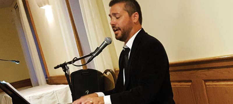 Tenor Michael DiMucci entertains members at a Scholarship Awards Program