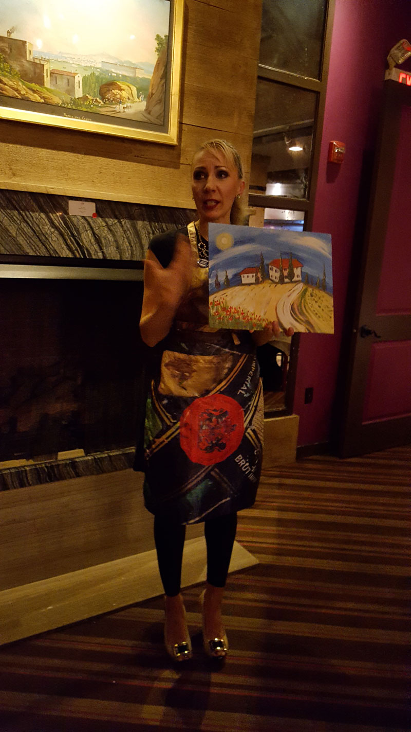 Artist Larisa Martino with painting