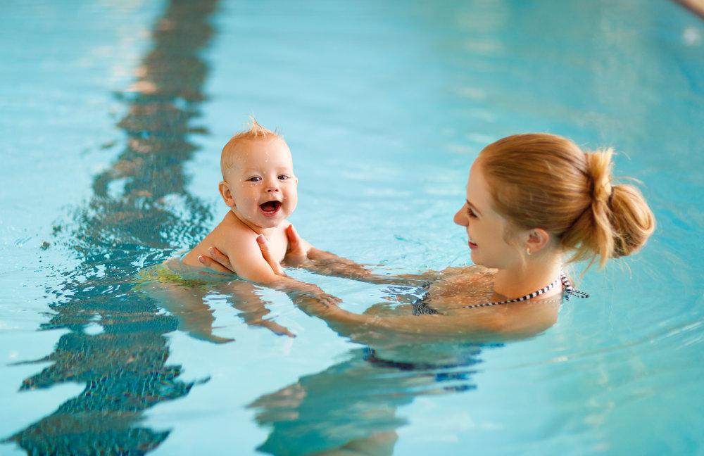 Baby swimming with mom at Brighton Swim Academy