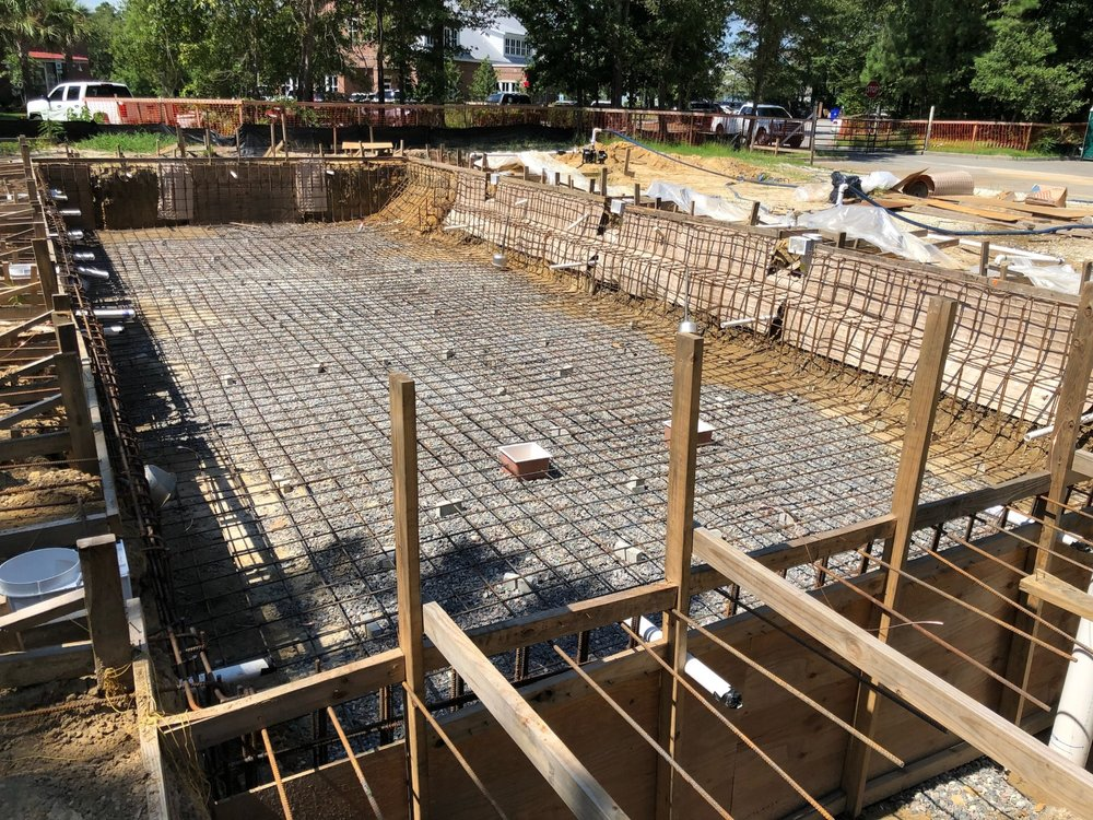 July 23, 2018: The pool has been dug and the rebar is installed.