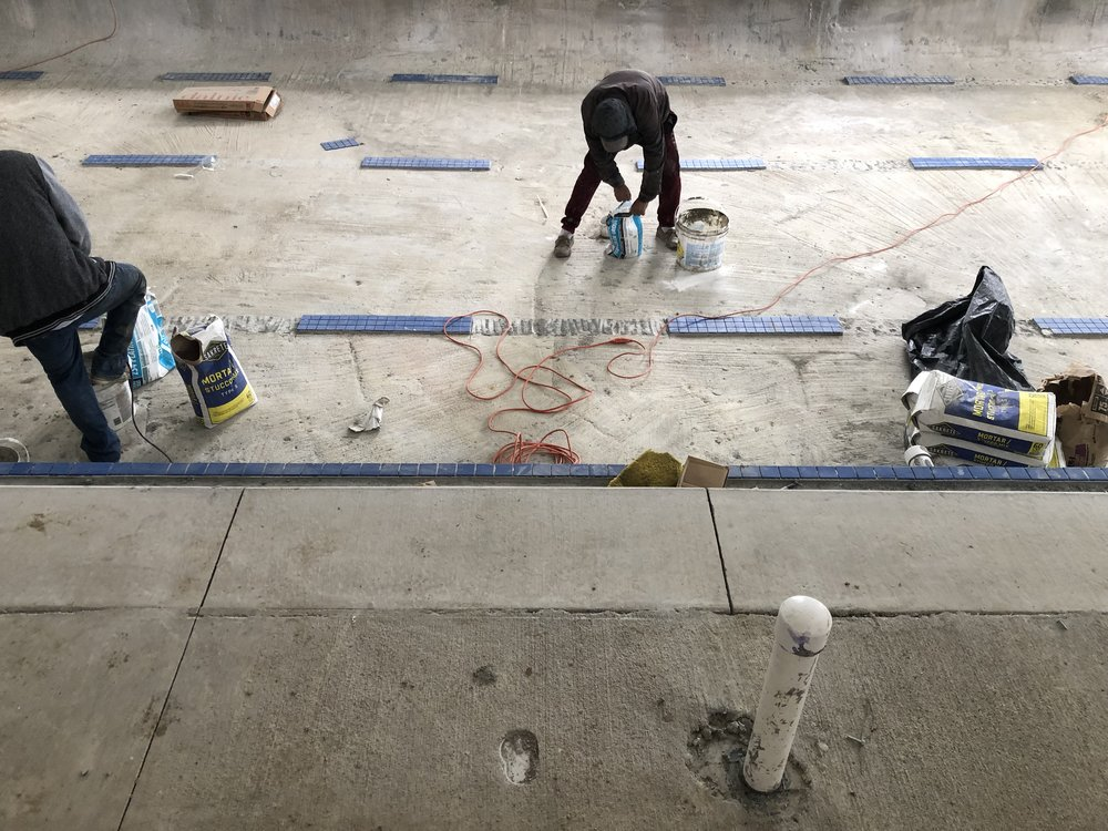 January 2019: Brighton has walls and the pool is being tiled.