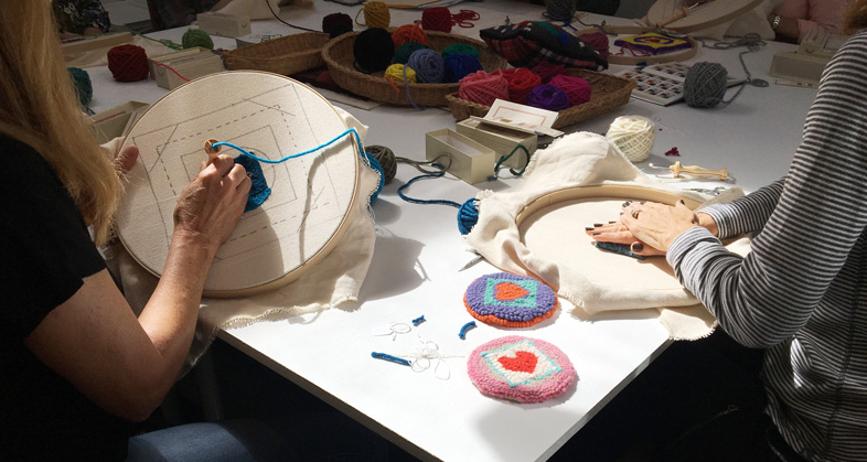 "Work in progress alongside finished examples of the ""mug rug"" coasters."