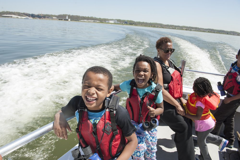 The Anacostia Community Museum Academy explores the Washington Channel and the Anacostia River aboard the Chesapeake Bay Foundation boat, The Susquehanna, 2014.  Photograph by Susana Raab,   Anacostia Community Museum Archives, Smithsonian Institution